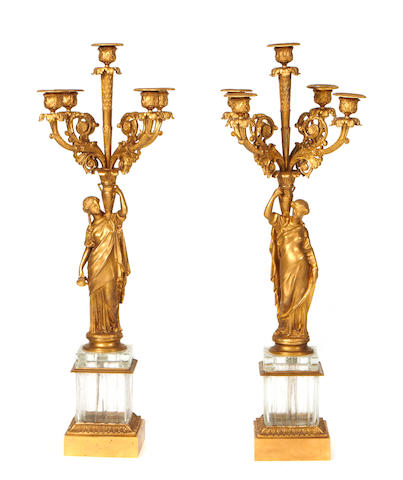 A pair of Empire style gilt bronze and glass five light candelabra