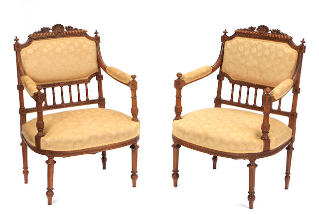A pair of Victorian Revival mahogany armchairs