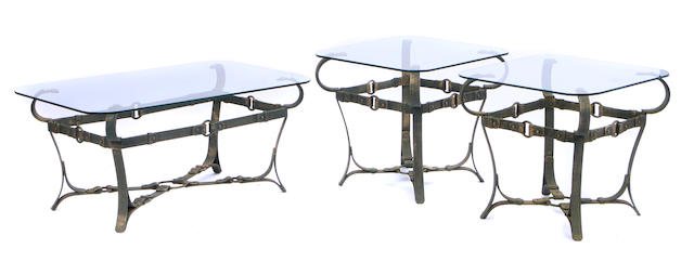 A suite of three wrought iron and glass belt motif tables
