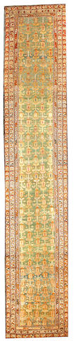 A Northwest runner Northwest Persia size approximately 3ft. 3in. x 15ft. 10in.