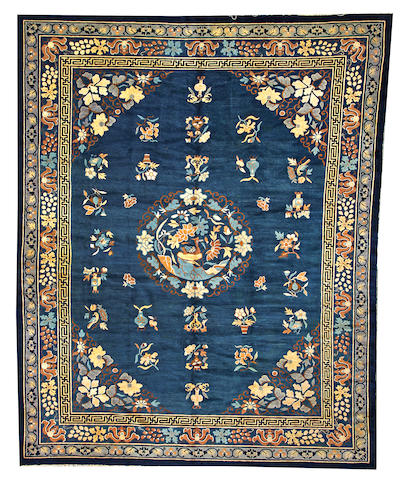 A Chinese carpet  China  size approximately 9ft. 4in. x 11ft. 6in.