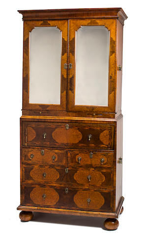 A William and Mary walnut and seaweed marquetry bureau bookcase in the manner of Gerritt Jensen<BR />fourth quarter 17th century