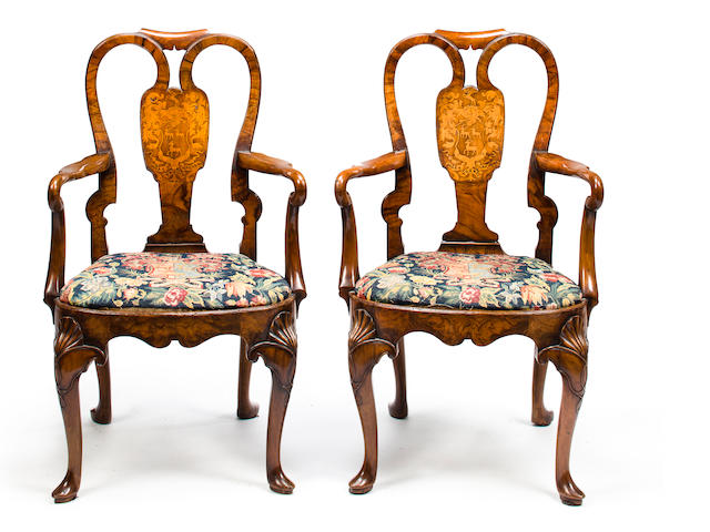 A pair of George I walnut and marquetry armchairs with the coat of arms of the Suckling family<BR />second quarter 18th century