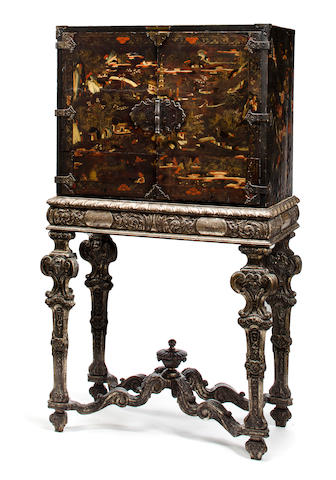 A Continental japanned cabinet on later silvered wood stand possibly Dresden, the cabinet late 17th/early 18th century, the stand second half 19th century