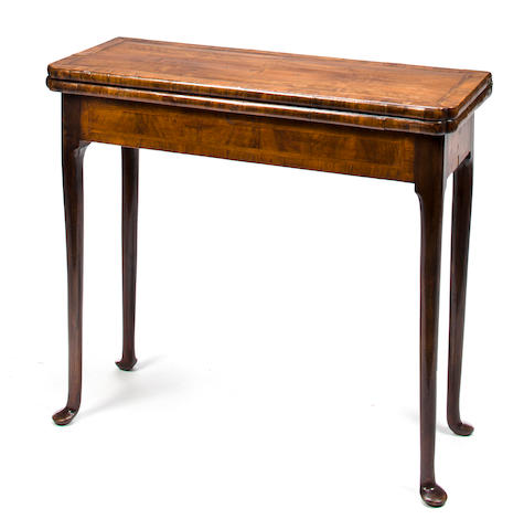 A George I walnut concertina action games table<BR />first quarter 18th century