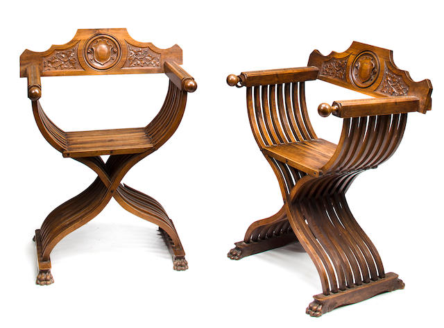 A pair of Renaissance style carved walnut folding chairs<BR /> second half 19th century