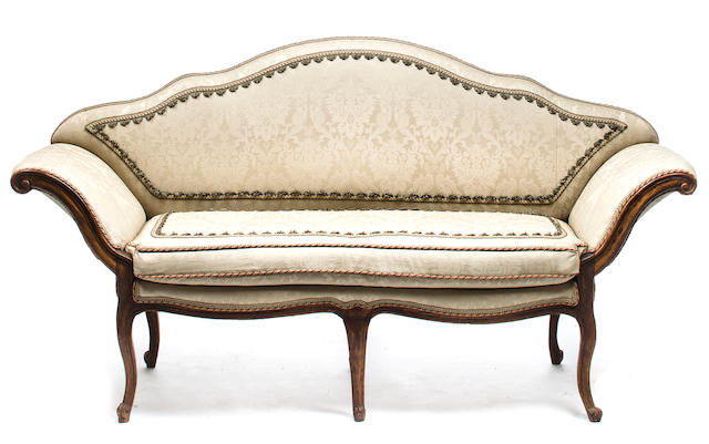 A Venetian Rococo carved walnut settee mid-18th century