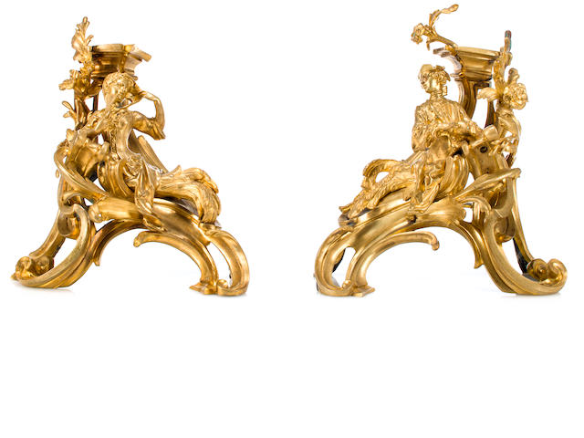 A pair of Louis XV style gilt bronze figural chenets<BR />mid-19th century