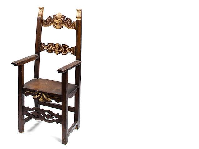 An Italian Baroque style parcel gilt walnut armchair<BR />19th century
