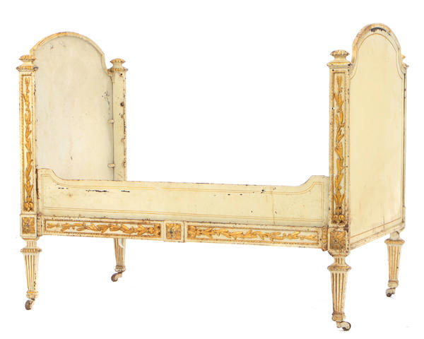 A Louis XVI style paint decorated parcel gilt cast iron bed