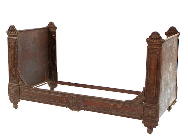 A Louis XVI style paint decorated cast iron daybed