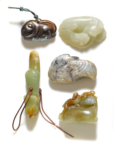 A group of five jade animal-shaped carvings