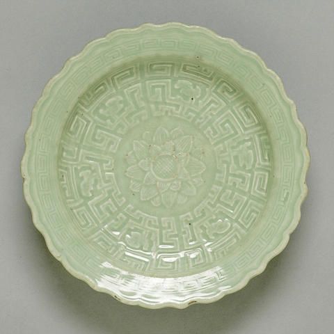 A celadon glazed porcelain molded dish 18th century