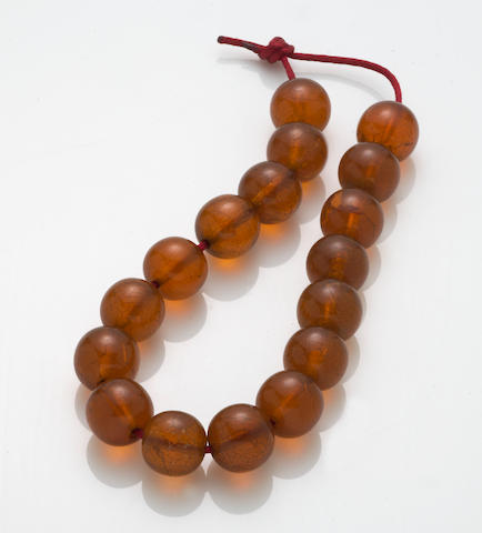 A string of seventeen amber beads