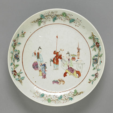 A famille rose export platter Late 18th/early 19th century check please.