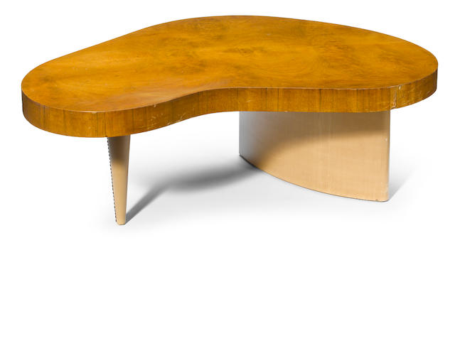 A Gilbert Rohde for Herman Miller paldao, acacia burl and leather cloth biomorphic coffee table model 4186, 1930s