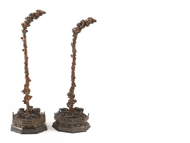 A pair of Chinese lacquered octagonal stands for lanterns with ruyi and cloud-form base Late Qing dynasty
