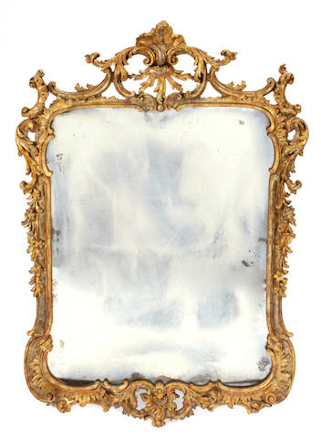 A Continental Rococo style carved giltwood mirror