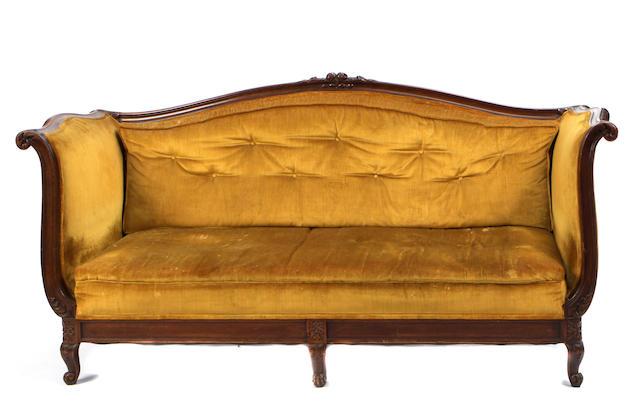 A Rococo style mahogany sofa