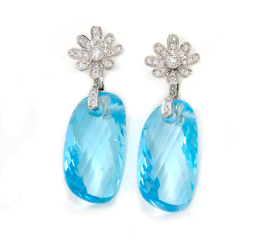 A pair of blue topaz and diamond pendant earrings