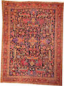A Heriz carpet  Northwest Persia size approximately 8ft. 7in. x 11ft. 6in.
