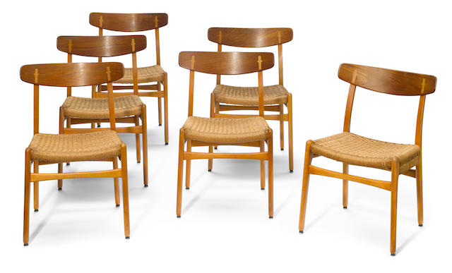 A set of six Hans Wegner oak and teak side chairs model CH-23, manufactured by Carl Hansen & Son, design introduced 1951