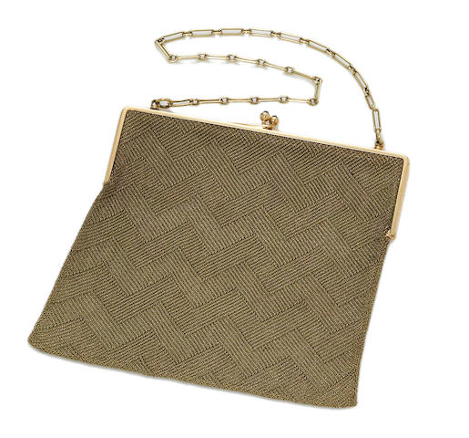 A fourteen karat gold mesh purse, Cartier