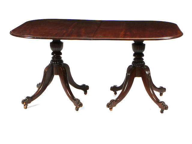 A late Regency mahogany twin pedestal dining table