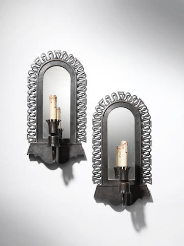 A pair of wrought iron wall lights French c 1940