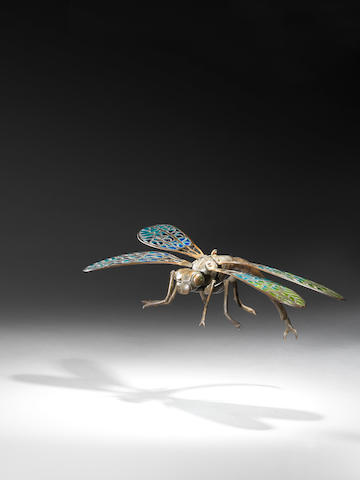 A Bronze Dragonfly French circa 1900  bronze and plique á jour  9 1/16 by 5 1/8 by 3 1/8 in. 23 by 13 by 8 cm.