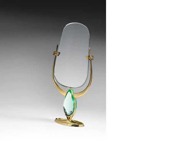 A vanity mirror on gilt metal and cut and polish glass and gilt metal stand, Fontana Arte 1960