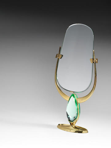 A vanity mirror on gilt metal and cut and polish glass and gilt metal stand, Fontana Arte 1960