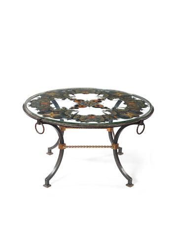Gilbert Poillerat for Merceris A Verre Églomisé Coffee Table the gilding attributed to Max Ingrand, circa 1935  wrought iron and gilded glass  Height: 20 1/2 in. 52 cm. Diameter: 36 1/4 in. 92 cm.