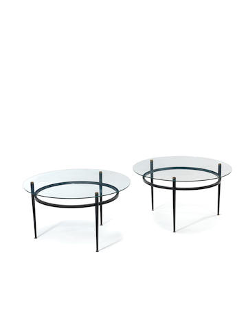 A pair of black painted and brass side tables with clear glass tops French c 1960