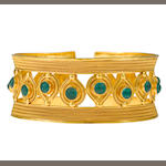 An emerald and 22k gold cuff bangle bracelet