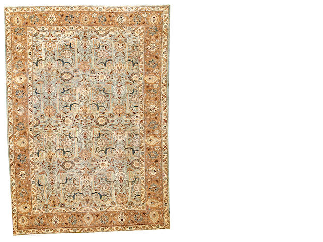 A Tabriz carpet  Northwest Persia size approximately 6ft. 10in. x 9ft. 7in.