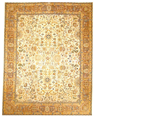 A Tabriz carpet  Northwest Persia size approximately 10ft. 3in. x 12ft. 10in.