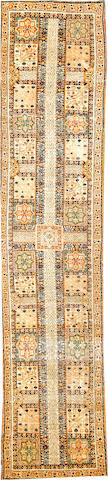 A Kerman runner South Central Persia size approximately 2ft. 9in. x 12ft. 4in.