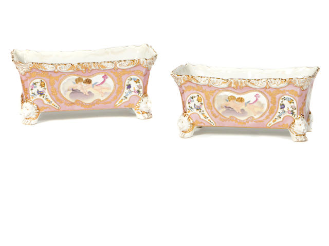 A pair of Louis XV style paint decorated porcelain jardiniéres