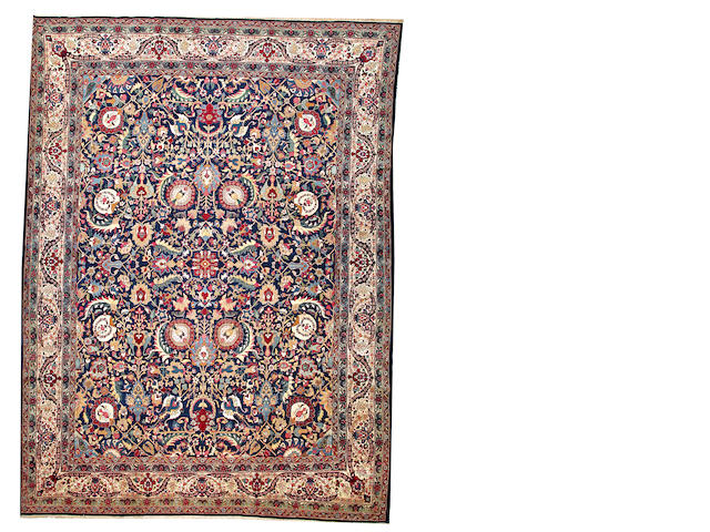 A Theran carpet  Central Persia size approximately 10ft. 3in. x 13ft. 10in.