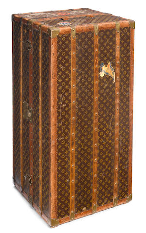 A Louis Vuitton printed canvas, enameled metal and wood wardrobe trunk circa 1930