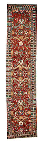 A Heriz runner  Northwest Persia size approximately 3ft. 2in. x 13ft. 9in.