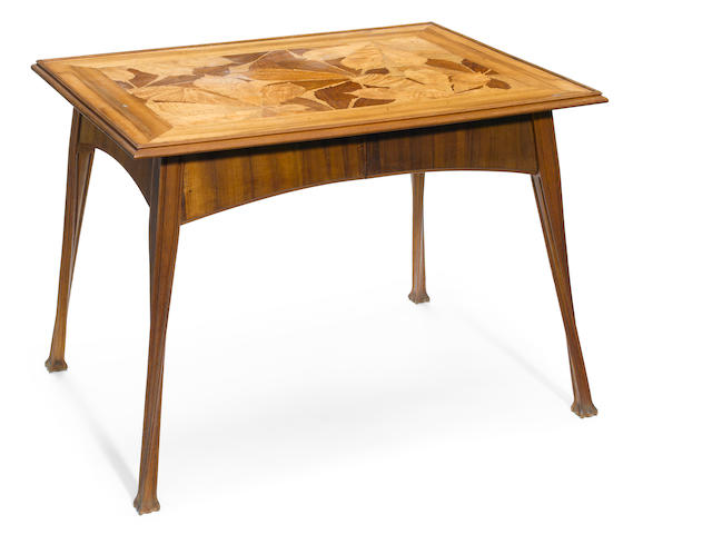 An Art Nouveau marquetry side table with chestnut leaf decoration circa 1900