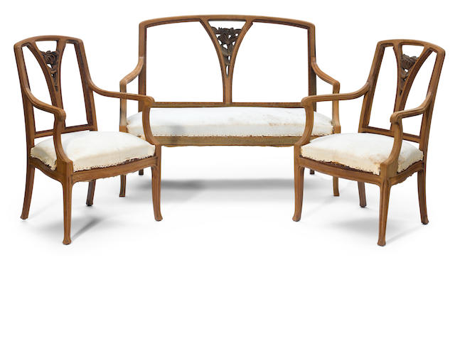 A French Art Nouveau carved wood salon suite  circa 1900