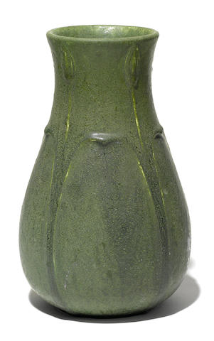 A Grueby green glazed pottery vase