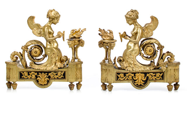 A pair of Louis XVI style gilt bronze figural chenets<BR />19th century