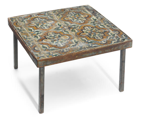 A modern metal frame table, top inset with antique Alhambra tile