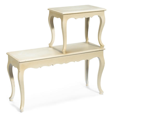 A Frances Elkins cream painted two-tiered side table