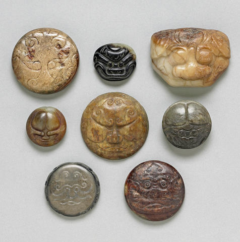 Eight hardstone and jade buttons