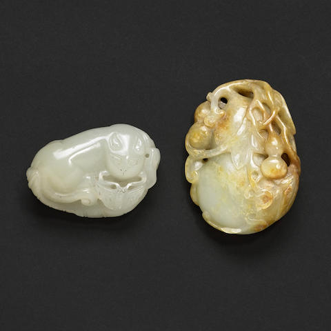 Two carved jade pebbles